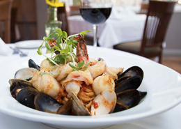 Michael's Back Door LINGUINE PESCATORE This linguine pasta dish (shown in photo) featuring fresh shrimp, scallops, mussels and clams in a white wine garlic basil tomato sauce has been a seafood lovers dream since 1981.
