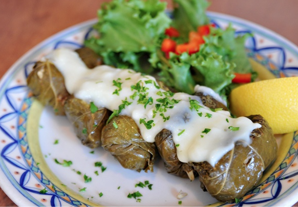 """Tony Pethakas of Mezes Restaurantwhich means a """"selection of appetizers"""". Dolmathes (stuffed green vine leaves)."""
