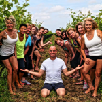 Practicing yoga in the vineyard atSouthbrook Vineyards withIgita Yoga instructor Tim Rivers.