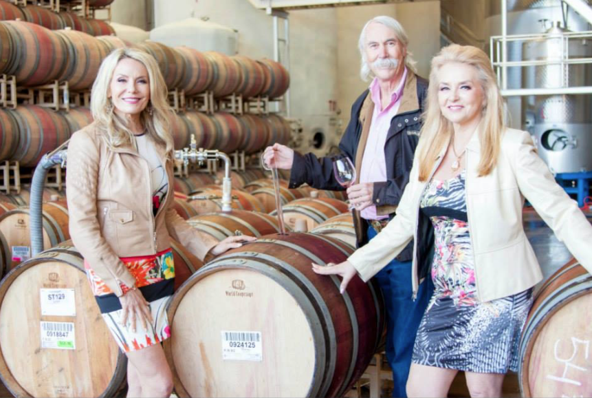 """In the barrel room at Vinwood Cellars, where several of Kendall-Jackson's key wines are made. Not open to the public, we are treated to lessons in """"battonage"""" and enjoyng a """"wine thief"""" or pipette experience. Drawing a sample of wine straight from the barrel."""