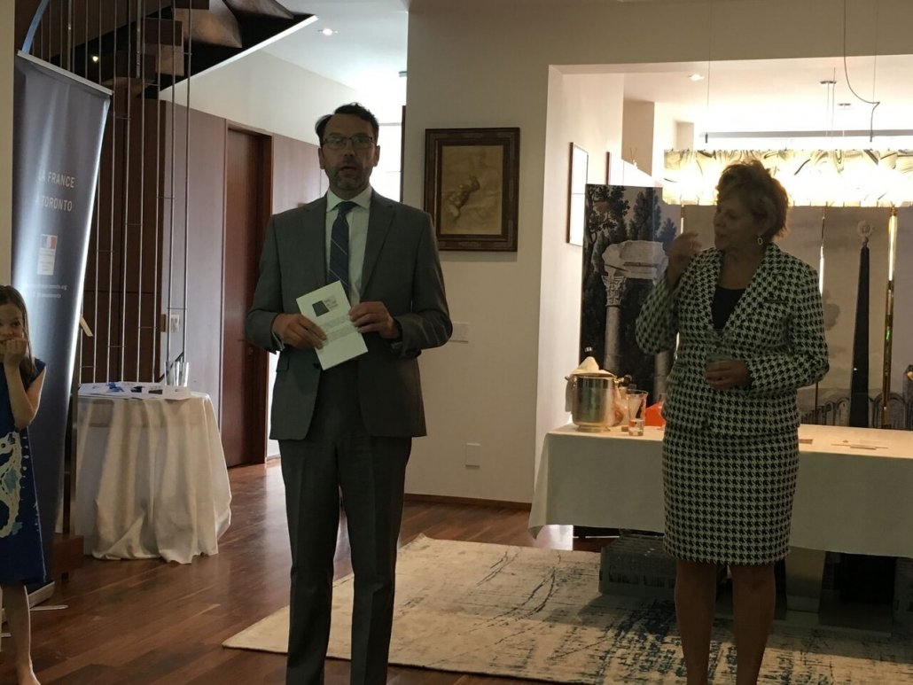Consul General Marc Trouyet and Liz Palmer welcome guests as the rose tasting is about to begin.