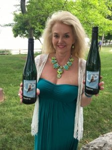 Susanne about to enjoy a delicious glass of Loosen Up Riesling on a Saturday afternoon by the lake.
