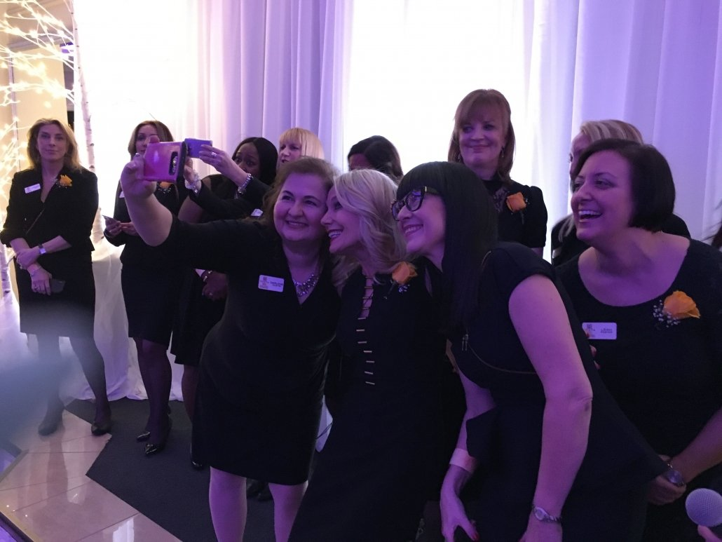 Zonta Oakville ladies on stage enjoying a selfie moment. Tag us #ZontaCelebratesIWD