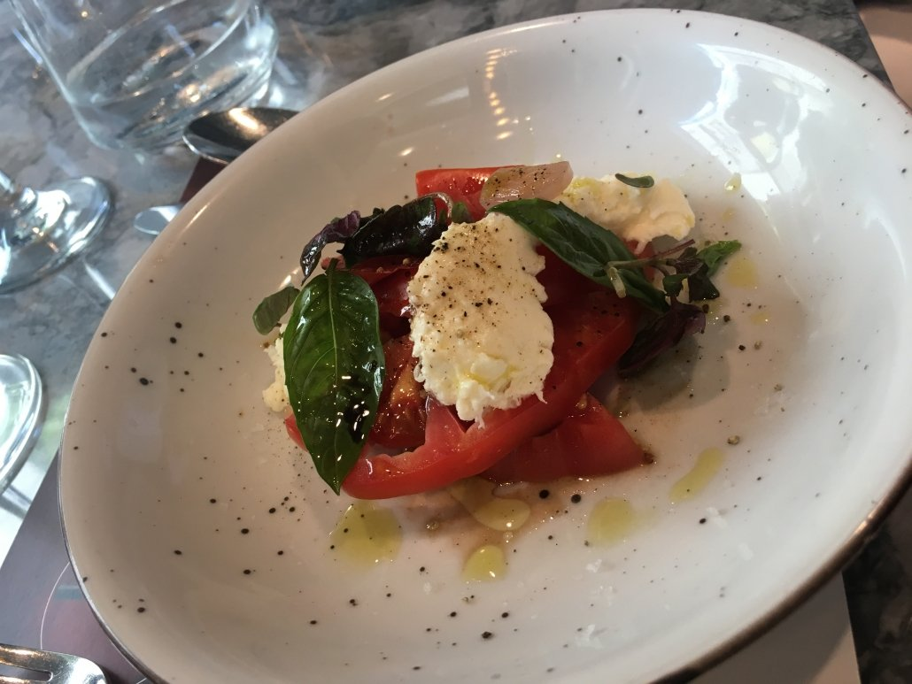 A beautiful pairing with two PRIMI course options; our delicious Heirloom Tomato Caprese, made with pickled shallot.